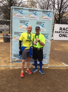 With my younger brother after his first marathon.  Enjoyed watching his proud marathon shuffle!